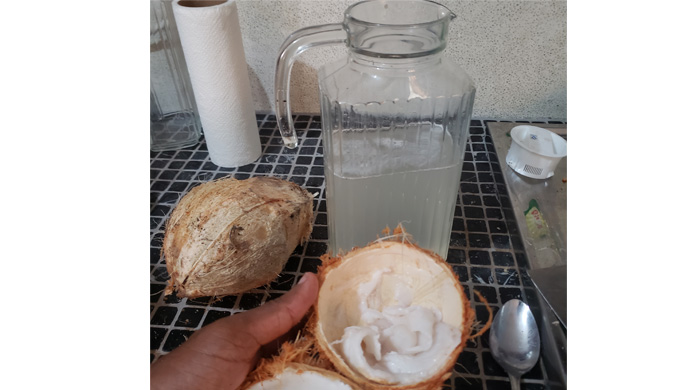 Getting Coconut Water And Jelly From Green Coconuts
